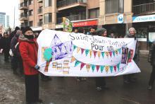 Bannière réalisée par des militantes du Comité populaire pour la Marche mondiale des femmes 2015